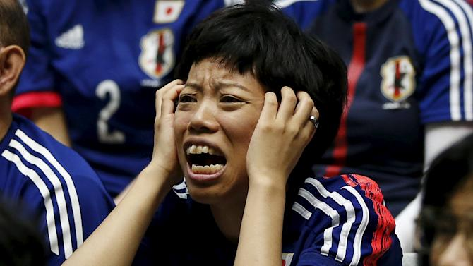 Japan soccer fan reacts as she watches Japan's FIFA Women's World Cup final match against the U.S. in Vancouver, at a public viewing event in Tokyo