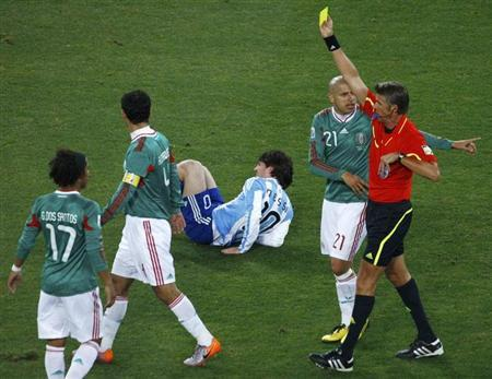 Referee Rosetti shows the yellow card to Mexico's Marquez during a 2010 World Cup second round soccer match at Soccer City stadium in Johannesburg