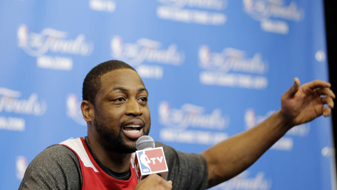 Miami Heat guard Dwyane Wade answers a question during a news conference on Saturday, June 7, 2014, in San Antonio. The team plays Game 2 of the NBA Finals against the San Antonio Spurs on Sunday. (AP Photo/Eric Gay)