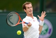 Britain's Andy Murray plays a forehand shot during his men's singles final match against Switzerland's Roger Federer on day 13 of the 2012 Wimbledon Championships tennis tournament at the All England Tennis Club in Wimbledon, southwest London. Federer won a record-equalling seventh Wimbledon title and 17th Grand Slam crown