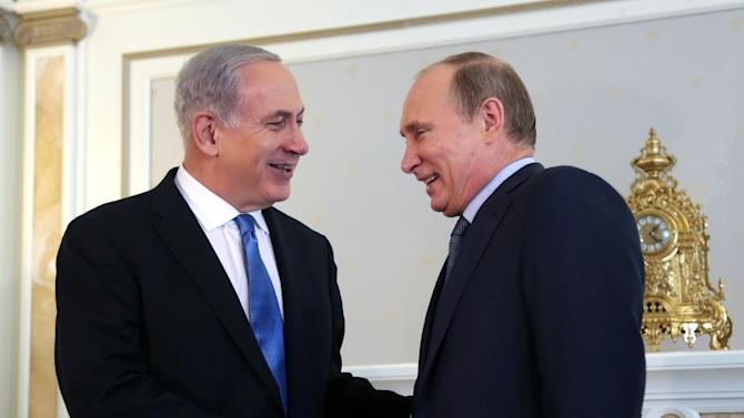 Russian President Vladimir Putin, right, shakes hands with Israeli Prime Minister Benjamin Netanyahu during their meeting at the Bocharov Ruchei residence in the Black Sea resort of Sochi, Russia, Tuesday, May 14, 2013. Putin hosting Netanyahu for talks focusing on the situation in Syria, amid concerns that Moscow could soon provide Damascus with advanced missiles. (AP Photo/ Maxim Shipenkov, pool)