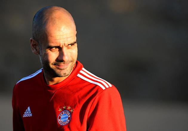 Bayern Munich's head coach Pep Guardiola arrives for a training session, on the eve of the FIFA Club World Cup final match against Morocco's Raja Casablanca, in the Moroccan city of arrakesh o