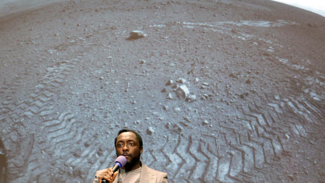 "Will.I.Am, with Black Eyed Peas, sings at Nasa's  Jet Propulsion Laboratory Tuesday Aug. 28, 2012, in Pasadena, Calif. The NASA rover Curiosity beamed to Earth his new song ""Reach for the Stars"" on Tuesday in the first music broadcast from another planet, to the delight of students who gathered at the Jet Propulsion Laboratory to listen. Earlier, engineers uploaded the song to the rover, which landed near the equator of Mars, and played it back _ a journey of some 700 million miles. (AP Photo/Nick Ut)"