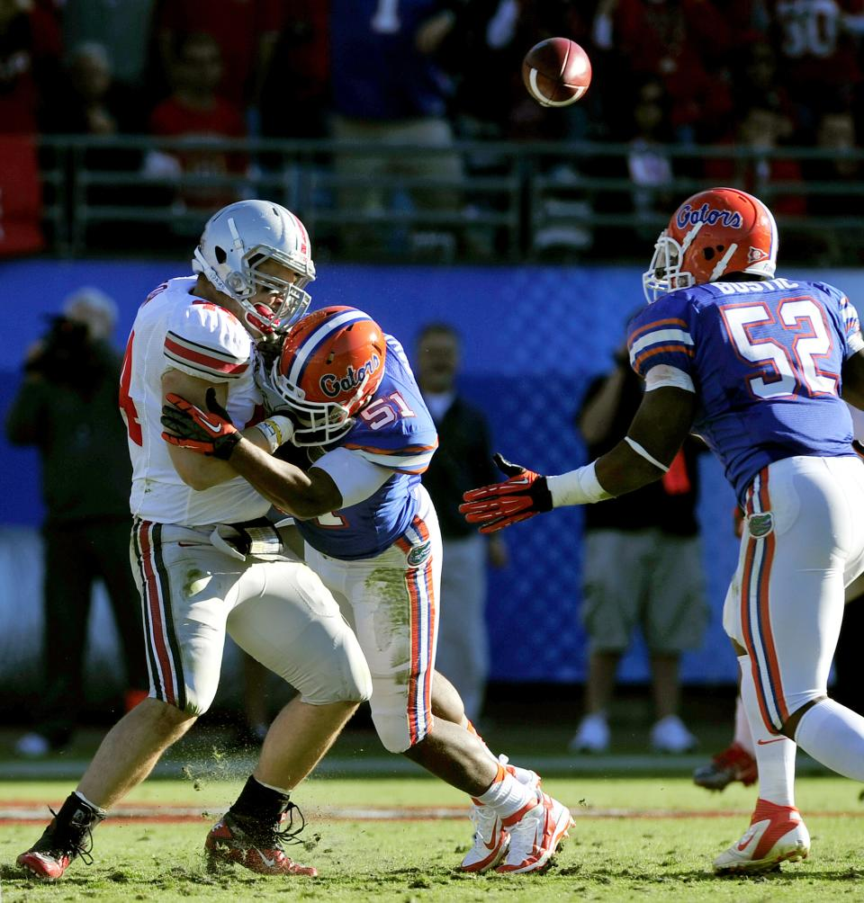 Florida linebacker Michael Taylor (51) hits Ohio State running back Zach Boren (44) and causes a fumble during the second half of the Gator Bowl NCAA college football game, Monday, Jan. 2, 2012, in Jacksonville, Fla. Florida recovered the fumble. Florida beat Ohio State 24-17. (AP Photo/Stephen Morton)