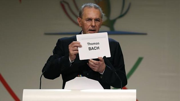 International Olympic Committee president Jacques Rogge holds up the name of Thomas Bach of Germany after he was elected the ninth president of the IOC (Reuters)