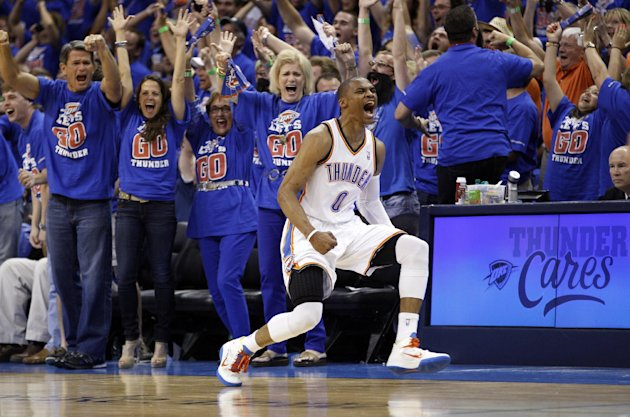 Oklahoma City Thunder guard Russell Westbrook (0) reacts after hitting a basket against the Los Angeles Lakers in the third quarter of Game 5 in their NBA basketball Western Conference semifinal playoff series, Monday, May 21, 2012, in Oklahoma City. (AP Photo/Sue Ogrocki)