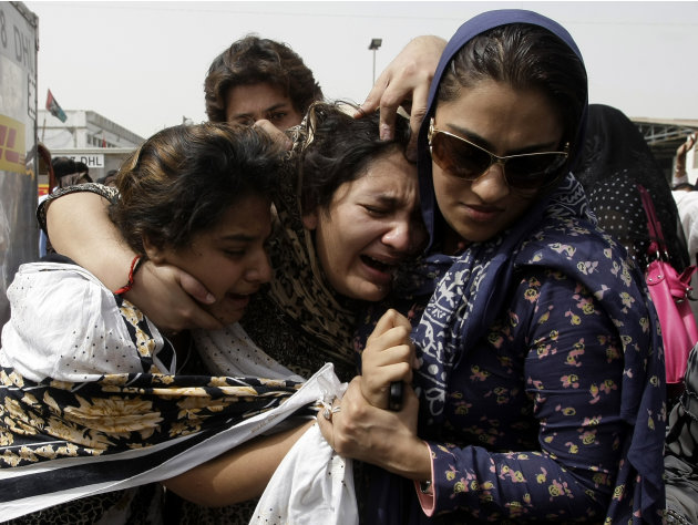 Family members of Pakistani acid attack victim Fakhra Younnus, mourn her death at Karachi airport in Pakistan on Sunday, March 25, 2012. Fakhra, who committed suicide by jumping from the sixth floor o