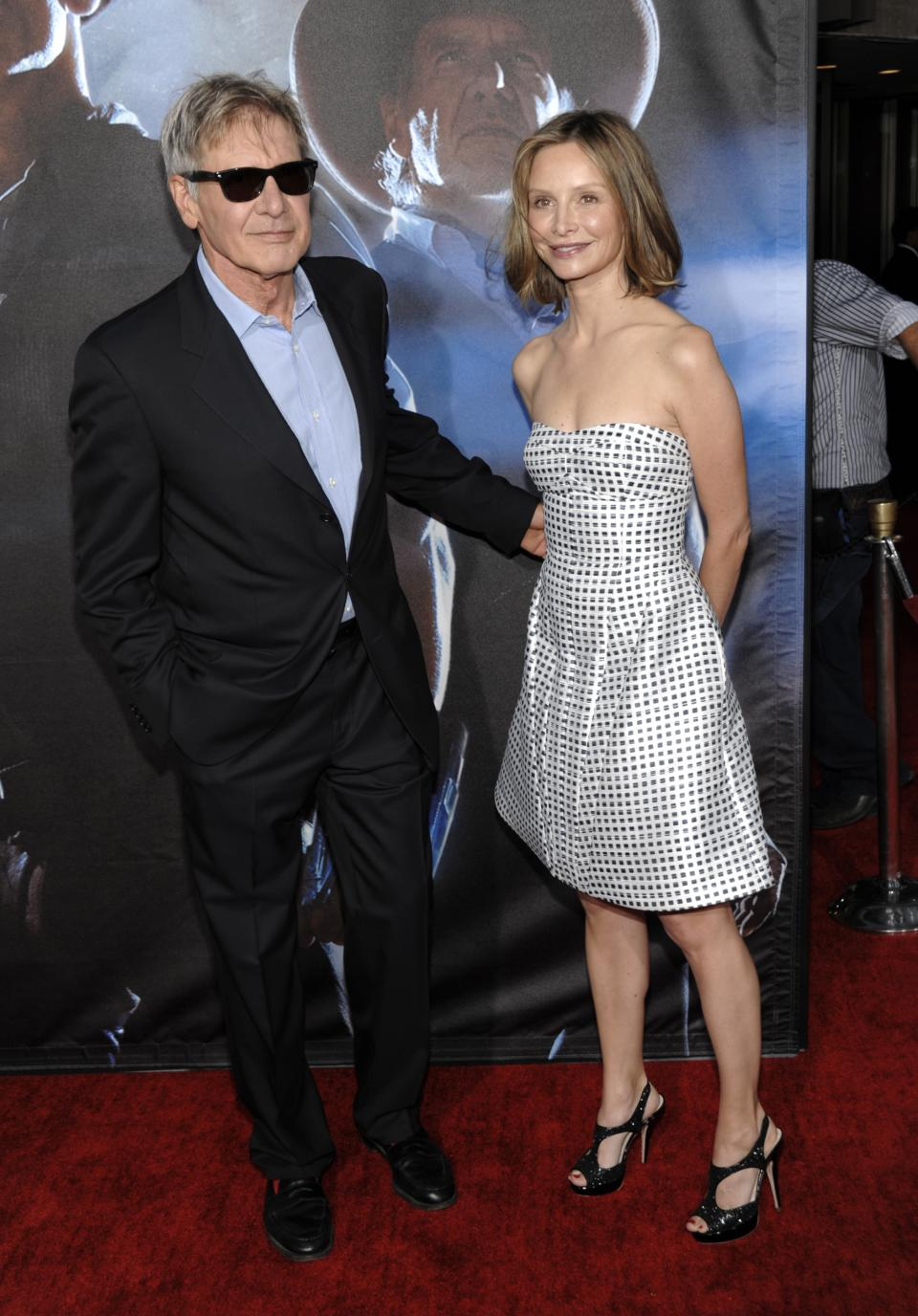 "Actor Harrison Ford, left, and actress Calista Flockhart arrive at the premiere of the feature film ""Cowboys and Aliens"" at Comic Con in San Diego, Calif. on Saturday, July 23, 2011. (AP Photo/Dan Steinberg)"