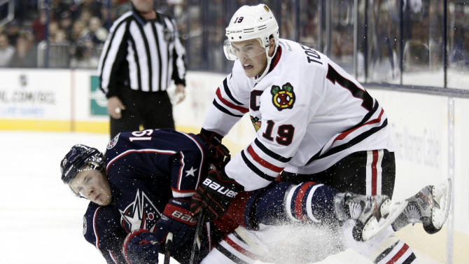 Chicago Blackhawks' Jonathan Toews, right, checks Columbus Blue Jackets' Ryan Johansen in the second period of an NHL hockey game in Columbus, Ohio,  Saturday, Jan. 26, 2013. (AP Photo/Paul Vernon)