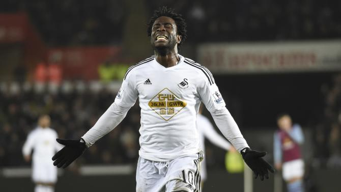 Swansea City's Wilfried Bony celebrates scoring a goal, that was later disallowed, during their English Premier League soccer match at the Liberty Stadium in Swansea