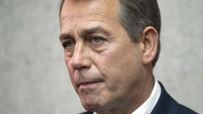 House Speaker John Boehner of Ohio pauses during a news conference on Capitol Hill in Washington, Friday, April 15, 2011. (AP Photo/Evan Vucci)