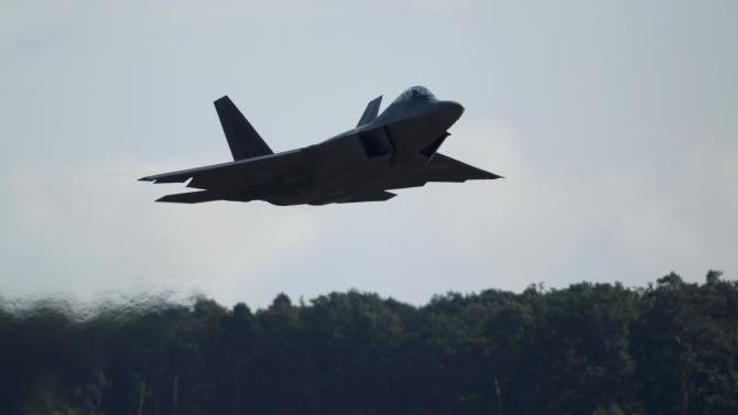 A U.S. Air Force F-22 Raptor fighter jet flies at low altitude over the Spangdahlem Air base