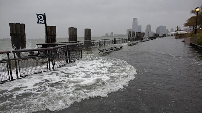 Waves wash over the seawall near high tide at Battery Park in New York, Monday, Oct. 29, 2012, as Hurricane Sandy approaches the East Coast. (AP Photo/Craig Ruttle)