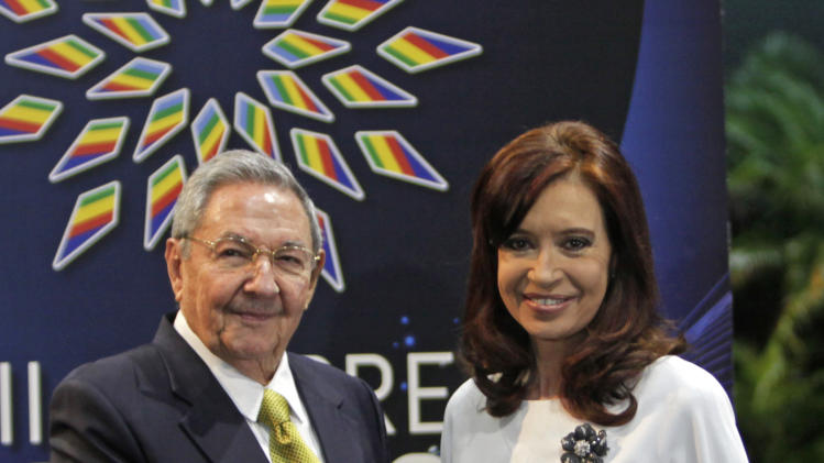Cuba's President Raul Castro greets Argentina's President Cristina Fernandez to the CELAC Summit in Havana, Cuba, Tuesday, Jan. 28, 2014. Leaders from Latin America and the Caribbean are in Cuba to talk about poverty and inequality at a summit of a regional bloc formed as a force for integration and a counterbalance to the U.S. (AP Photo/ Cubadebate, Ismael Francisco)