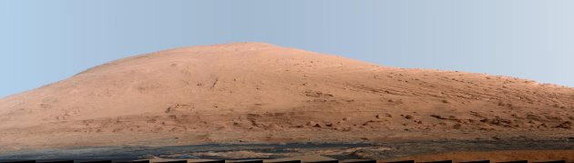 A portion of Mount Sharp, on Mars is pictured in this panorama made from a mosaic of images taken by the Mast Camera (Mastcam) on NASA&#39;s Mars rover Curiosity September 20, 2012 and released as a NASA handout image March 15, 2013. The photo has a white-balanced color adjustment that makes the sky look overly blue but shows the terrain as if under Earth-like lighting.  REUTERS/NASA/JPL-Caltech/MSSS/Handout   (OUTER SPACE - Tags: ENVIRONMENT SCIENCE TECHNOLOGY) FOR EDITORIAL USE ONLY. NOT FOR SALE FOR MARKETING OR ADVERTISING CAMPAIGNS