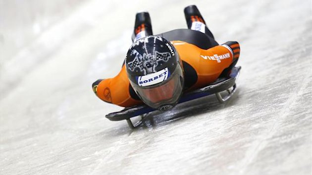 "Germany's Marion Thees speeds down the track in the women's skeleton test event at the ""Sanki"" sliding center in Rosa Khutor, a venue for the Sochi 2014 Winter Olympics near Sochi February 16, 2013 (Reuters)"