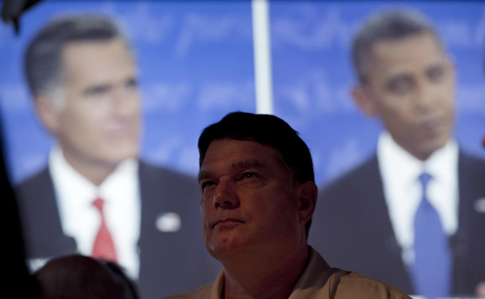 Calvin Goad watches the first presidential debate between President Barack Obama and Republican presidential nominee Mitt Romney from a restaurant in San Diego, Wednesday, Oct. 3, 2012. (AP Photo/Gregory Bull)