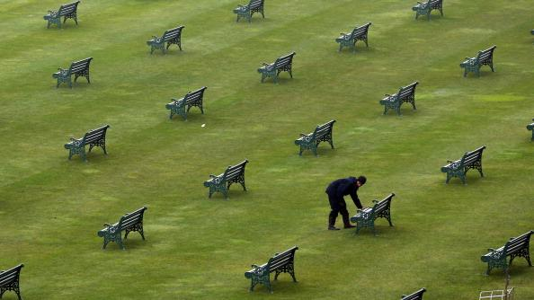 A worker check benches in the Grandstand on Ladies Day at Royal Ascot on June 21, 2012 in Ascot, England. Ladies Day is traditionally the fashion highlight of the five day race meeting. (Photo by Peter Macdiarmid/Getty Images)