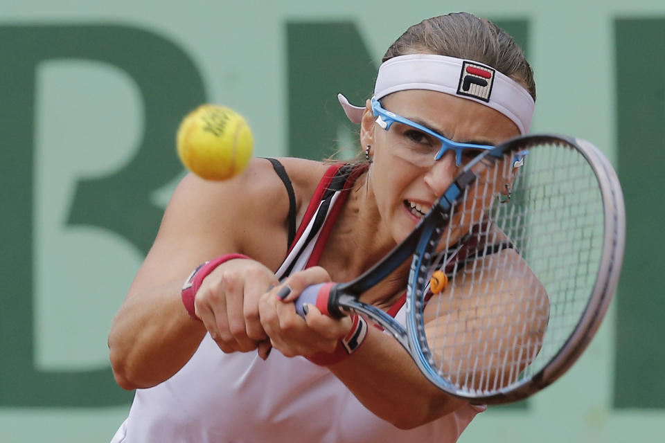 Yaroslava Shvedova of Kazakhstan returns in her quarter final match against Petra Kvitova of the Czech Republic at the French Open tennis tournament in Roland Garros stadium in Paris, Wednesday June 6, 2012. Kvitova won in three sets 3-6, 6-2, 6-4. (AP Photo/Michel Euler)