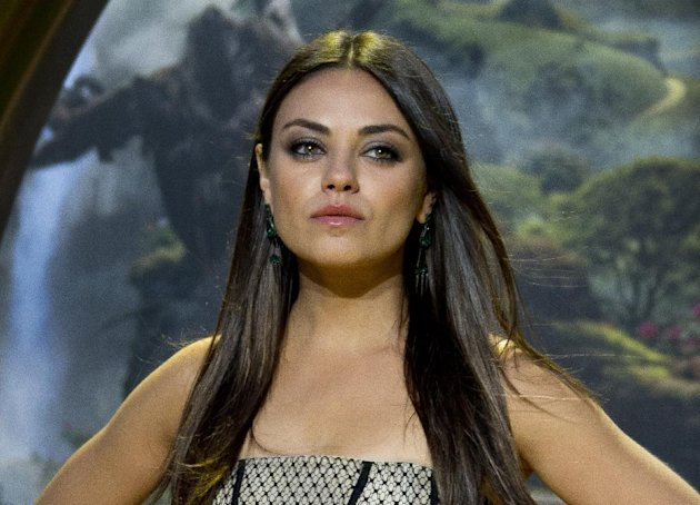"In this Feb. 28, 2013 photo, Actress Mila Kunis arrives at the European premiere of Oz: The Great And Powerful in London. Kunis' stardom and general idolization went up a notch last week, and you would think this is because she stars in the biggest movie of the year so far. But ""Oz the Great and Powerful,"" which debuted with $79.1 million at the box office, had hardly anything to do with the sudden rush of adulation that engulfed Kunis. Instead, it was a seven-minute viral video that's been watched more than 10 million times and blogged about the world over.(Photo by Joel Ryan/Invision/AP)"