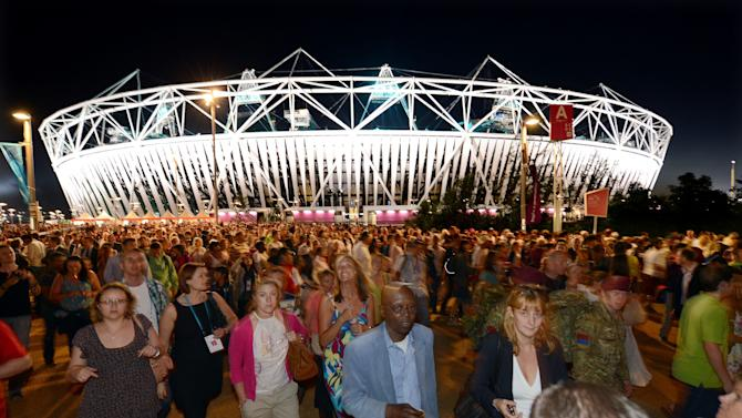 In this Monday July 23, 2012 file photo, crowds leave the Olympic Stadium at the Olympic Park in London, following the dress rehearsal for the Opening Ceremony for the 2012 Olympic Games.  (AP Photo/John Giles, PA) UNITED KINGDOM OUT