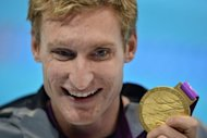 US swimmer Bradley Snyder poses with his gold medal after winning the men's 100m freestyle - S11 final swimming event at the London 2012 Paralympic Games at the Olympic Park's Aquatics Centre in east London on August 31