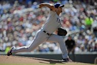 Yu Darvish of the Texas Rangers delivers a pitch against the Minnesota Twins during the first inning at Target Field in Minneapolis, Minnesota. Darvish pitched 5 2/3 innings for the Texas Rangers on Saturday, departing with the score deadlocked before the Rangers defeated host Minnesota 6-2 in a Major League Baseball game