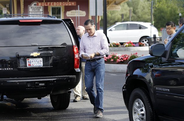 Republican presidential candidate, former Massachusetts Gov. Mitt Romney looks at a shopping list as he arrives at Bradley's Hardware in Wolfeboro, N.H., Monday, Aug. 6, 2012. (AP Photo/Charles Dharapak)
