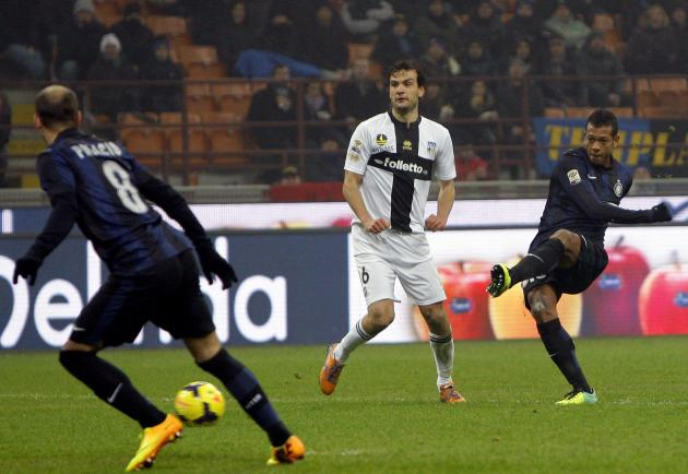 Inter Milan's Guarin shoots to score the third goal against Parma during their Italian Serie A soccer match in Milan