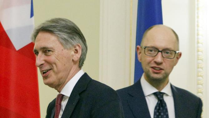 British Foreign Secretary Hammond and Ukraine's Prime Minister Yatseniuk arrive for their meeting in Kiev