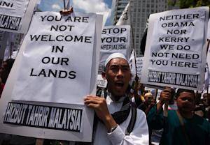Muslim protesters at a protest in Kuala Lumpur on October …