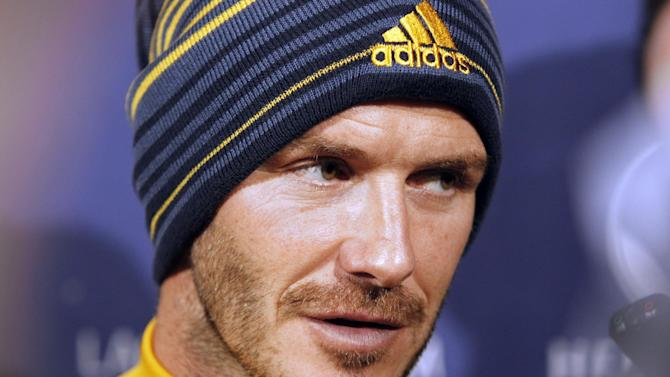Los Angeles Galaxy's David Beckham, of England, talks with reporters during a news conference in Carson, Calif., Tuesday, Nov. 20, 2012.  Beckham will play his final soccer  game for the Galaxy in the MLS Cup next month. (AP Photo/Alex Gallardo)