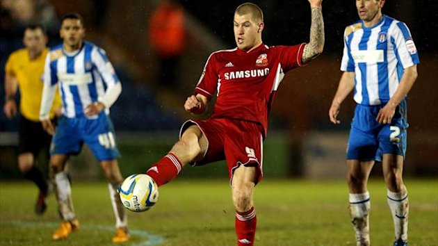 James Collins opened the scoring for Swindon, who have gone top of League One