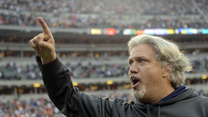 Dallas Cowboys defensive coordinator Rob Ryan leaves the field after the Cowboys defeated the Cincinnati Bengals 20-19 in an NFL football game, Sunday, Dec. 9, 2012, in Cincinnati. (AP Photo/Michael Keating)