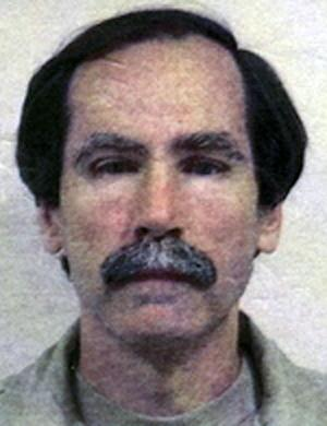 """FILE - This undated file image provided by the Department of Justice shows convicted serial rapist Christopher Hubbart. The """"Pillowcase Rapist,"""" known by the moniker because he used a pillowcase to muffle his victims' screams, moved into his new home outside of Palmdale, about 70 miles northeast of downtown Los Angeles, earlier this week amid community protests. He's acknowledged raping or assaulting 40 women between 1971 and 1983. (AP Photo/Department of Justice, File)"""