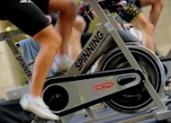 Participants ride exercise bikes during a group outdoor fitness promotion in Sydney. Researchers have found that brisk walking for up to 75 minutes per week was associated with a gain of 1.8 years in life expectancy