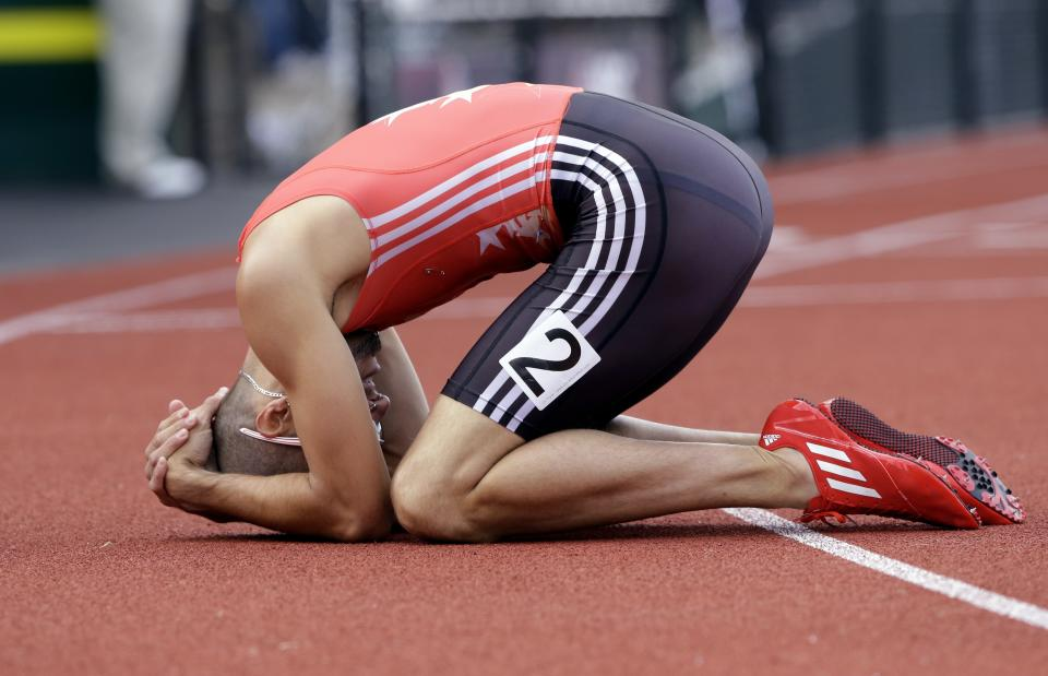 Jeremy Wariner reacts after the men's 400m finals at the U.S. Olympic Track and Field Trials Sunday, June 24, 2012, in Eugene, Ore. (AP Photo/Eric Gay)