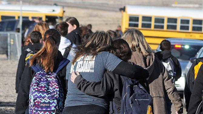 students are escorted from Berrendo Middle School in Roswell, N.M., after a shooting incident