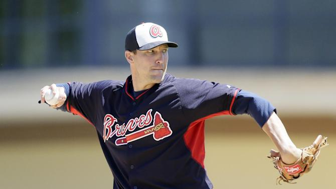 FILE - In this March 30, 2015, file photo, Atlanta Braves relief pitcher Jim Johnson throws during the fifth inning of a spring training exhibition baseball game against the Detroit Tigers in Lakeland, Fla. Reliever Jim Johnson is returning to the Atlanta Braves, agreeing to a $2.5 million, one-year contract. The Braves announced the deal Monday, Nov. 30, 2015. (AP Photo/Carlos Osorio, File)