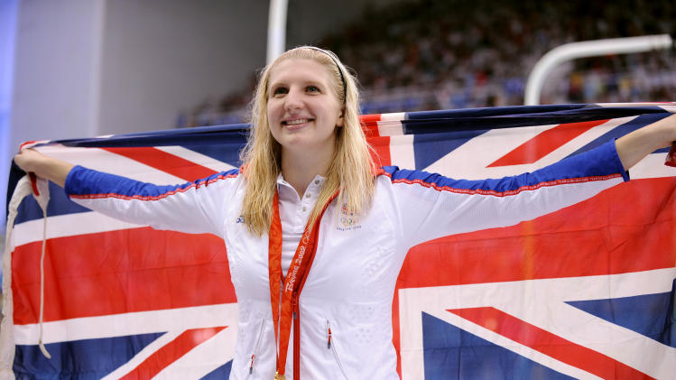 "FILE - In this Saturday, Aug. 16, 2008 file photo Britain's Rebecca Adlington shows her gold medal after the women's 800-meter freestyle semi-final during the swimming competitions in the National Aquatics Center at the Beijing 2008 Olympics. Two-time Olympic swimming gold medalist Rebecca Adlington says she is giving up on Twitter during the London 2012 Games because of the nasty comments she receives about her looks. Adlington says she is fed up with the ""awful'' abuse on Twitter and other social networks. (AP Photo/Mark J. Terrill, file)"