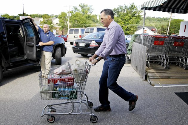 Republican presidential candidate, former Massachusetts Gov. Mitt Romney pushes a shopping cart after buying groceries at  Hunter's Shop and Save supermarket in Wolfeboro, N.H., Monday, Aug. 6, 2012.
