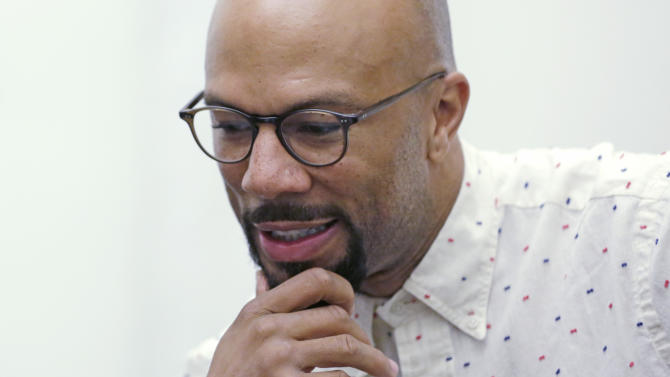 """Rapper Common speaks about the violence that has plagued his hometown during an interview with The Associated Press Friday, Sept. 20, 2013, in Chicago. The Grammy-award wining hip hop artist who has openly worried about the violence in Chicago, was in his hometown to help celebrate the city's music scene, when he was confronted with a brutal reminder of what he's been talking about: a story about a hail of gunfire that wounded 13 people the night before. """"It makes me think I got to do more; we got to do more,"""" he said during the interview. Common spoke after giving a speech as the keynote speaker at the Chicago Music Summit, a conference to help local musicians and music professionals with their careers. (AP Photo/M. Spencer Green)"""