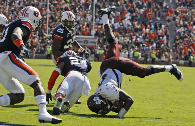 Mississippi State quarterback Chris Relf (14) is upended short of the goal line on the final play of the game as Auburn defensive back Ryan Smith (24) defends during an NCAA college football game in A
