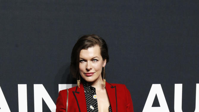 Actress Jovovich poses as she arrives for the Saint Laurent fall collection fashion show at the Hollywood Palladium in Los Angeles