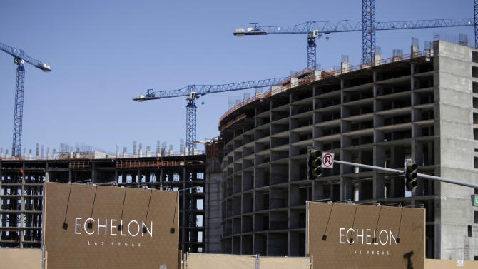File-This May 2009 file photo showing tourists walking past the construction site of Boyd Gaming's Echelon project in Las Vegas. A Malaysian conglomerate said Monday, March 4, 2013, it will break ground next year on a project that could breathe new economic life into a tired stretch of the Las Vegas Strip where work has stalled during the recession. The Genting Group said it will pay $350 million for the 87-acre site where the partially built Echelon project by Boyd Gaming Corp. came to a halt nearly five years ago. (AP Photo/Jae C. Hong,File)