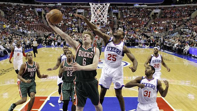 Hawes lifts 76ers over Bucks 115-107 in OT