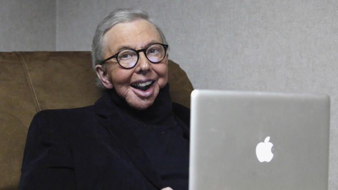 FILE - In this Jan. 12, 2011 file photo, Pulitzer Prize-winning movie critic Roger Ebert works in his office at the WTTW-TV studios in Chicago. Ebert, who worked at the Chicago Sun-Times for more than 40 years, took first place for online columns or blogs on large websites in the NSNC's annual column contest. (AP Photo/Charles Rex Arbogast, File)