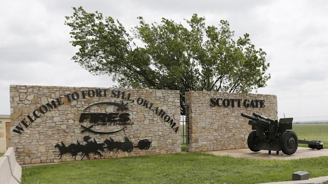 A sign is pictured at Scott Gate, one of the entrances to Fort Sill, in Fort Sill, Okla., Tuesday, June 17, 2014. (AP Photo/Sue Ogrocki)