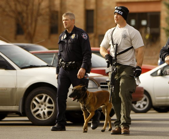 Casper police leave the Wold Physical Science Building while investigating a murder and suicide at Casper College, Friday Nov. 30, 2012,