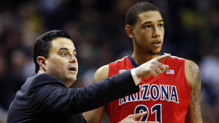 FILE - In this Jan. 10, 2013 file photo, Arizona head coach Sean Miller, left, directs Brandon Ashley during the second half of their NCAA college basketball game against Oregon, in Eugene, Ore. There are a wide range of title contenders in this college basketball season, including Arizona. (AP Photo/Chris Pietsch, File)